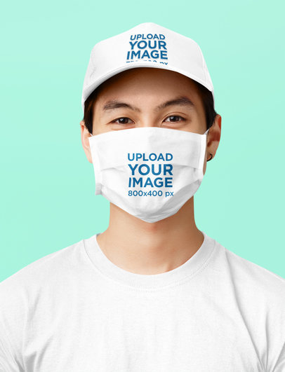 Dad Hat and Face Mask Mockup of a Smiling Man in a Studio 43967-r-el2
