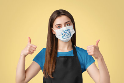 Face Mask Mockup Featuring a Cheery Waitress in a Studio 43972-r-el2