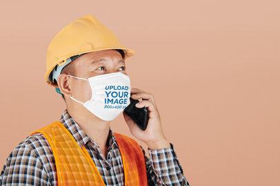 Face Mask Mockup Featuring a Man With a Construction Helmet at a Studio 44171-r-el2