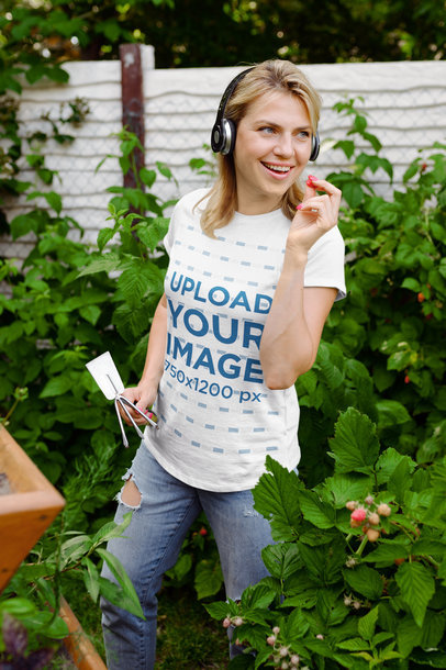 T-Shirt Mockup Featuring a Female Gardener Eating a Berry 44048-r-el2