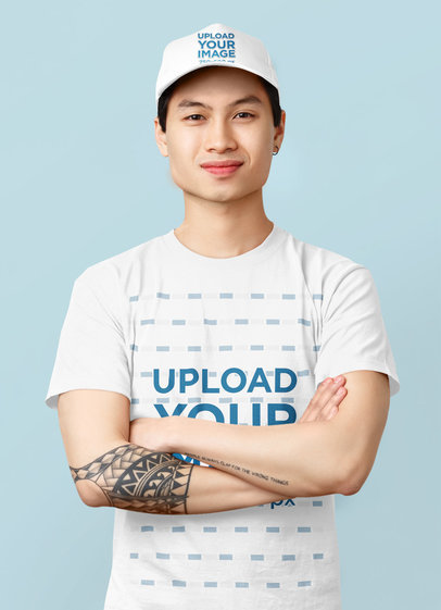 Mockup of a Man with a Tattoo Wearing a Dad Hat and a Basic T-Shirt 44181-r-el2