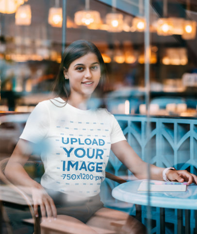Mockup Featuring a Young Woman Wearing a T-Shirt at a Cafe 42175-r-el2