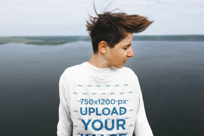 Mockup of a Teenager with a Long-Sleeve Tee Standing by a Lake 44015-r-el2