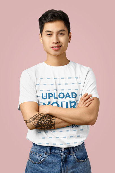 T-Shirt Mockup of a Young Man with a Tattoo Posing in a Studio 43246-r-el2