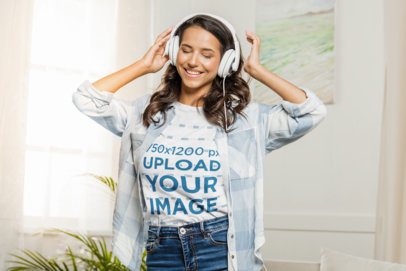 T-Shirt Mockup of a Woman Happily Listening to Music at Home 43895-r-el2