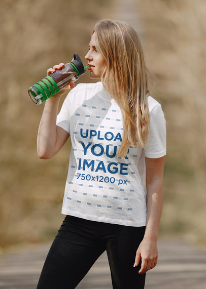 Mockup of a Woman Wearing a T-Shirt While Drinking Water at a Park 41366-r-el2