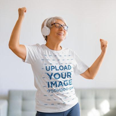T-Shirt Mockup Featuring a Senior Woman Dancing at Home 44659-r-el2