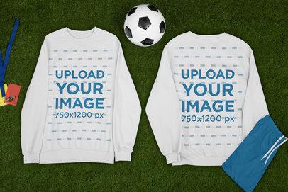 Mockup of Two Sweatshirts Lying by a Soccer Ball m387