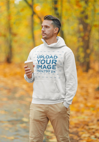 Hoodie Mockup Featuring a Serious Man Walking Through an Autumn Forest 44621-r-el2