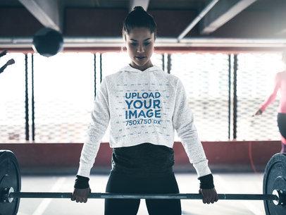 Mockup of a Woman Wearing a Heathered Crop Top Hoodie at the Gym 41653-r-el2