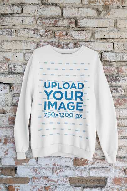 Mockup of a Sweatshirt Hanging on an Old Brick Wall m435