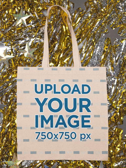 Mockup of a Flat Laid Tote Bag over Metallic Paper Strips m296