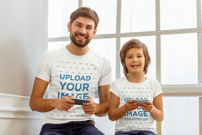 T-Shirt Mockup of a Man and His Son Playing Mobile Games 44918-r-el2