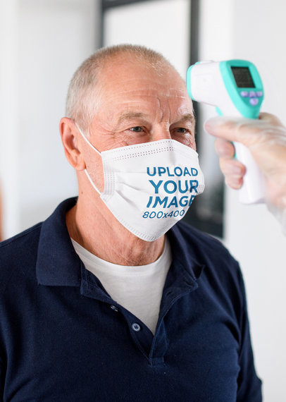 Face Mask Mockup of a Senior Man Getting His Temperature Checked 44896-r-el2