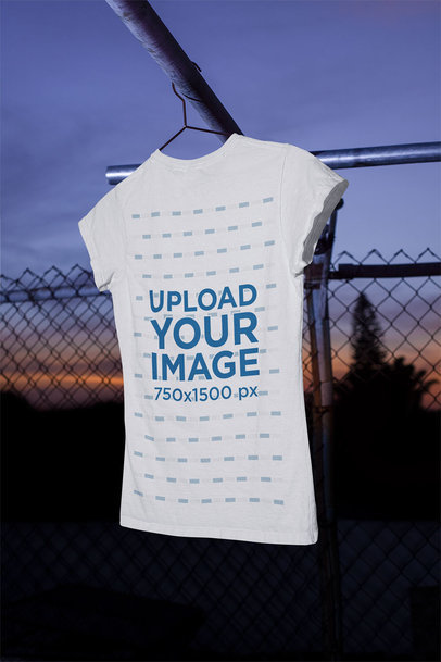 Mockup of a Women's T-Shirt Hanging Featuring the Sunset in the Background m487
