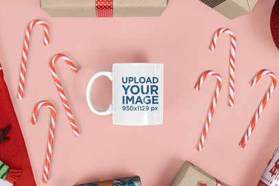 Mockup of an 11 oz Coffee Mug Surrounded by Christmas Candy Canes m19