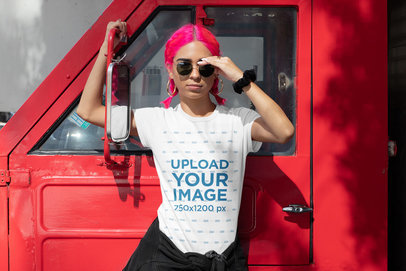 T-Shirt Mockup of a Pink-Haired Woman Posing by a Truck m410