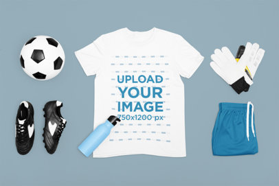 Mockup of a Flat Laid T-Shirt Surrounded by Soccer Equipment m310