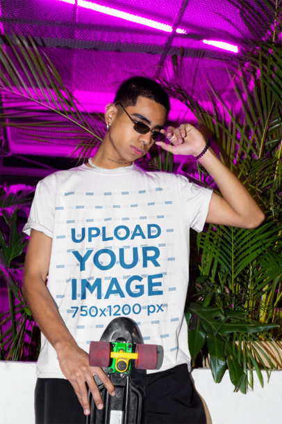 T-Shirt Mockup Featuring a Young Man Posing with a Longboard m585