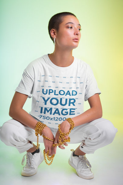 T-Shirt Mockup of a Woman Holding a Golden Chain in Her Hands m651