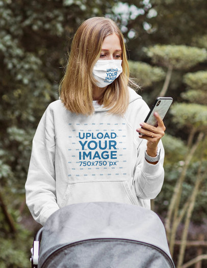 Face Mask and Hoodie Mockup of a Young Mom Taking Her Baby to a Stroll 45334-r-el2