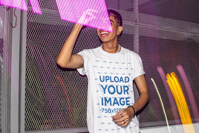 T-Shirt Mockup Featuring a Man Surrounded by Neon Lights m583