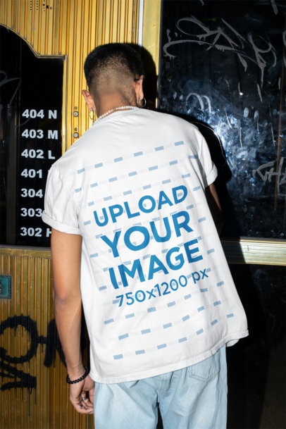Back View T-Shirt Mockup of a Man Trying to Open a Door m579