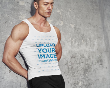 Tank Top Mockup Featuring a Muscular Man Leaning Against a Wall 35435-r-el2