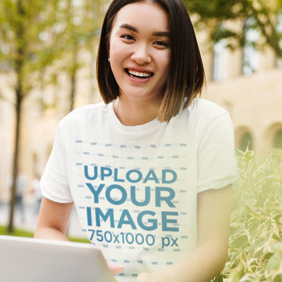 T-Shirt Mockup of a Smiling Woman with Short Hair Using Her Computer 45674-r-el2