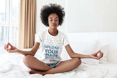 Tee Mockup of a Woman Meditating on Her Bed 45291-r-el2
