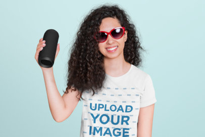 T-Shirt Mockup Featuring a Young Woman with Curly Hair Holding a Speaker 45619-r-el2