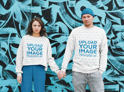 Sweatshirt Mockup Featuring a Serious Couple Posing by a Graffiti Wall 45659-r-el2