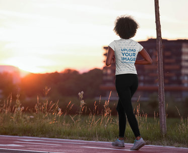 Back View T-Shirt Mockup of a Woman Walking on a Running Track 45392-r-el2
