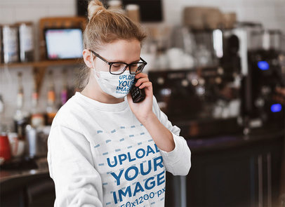 Face Mask and Sweatshirt Mockup Featuring a Woman on the Phone at Work 45482-r-el2