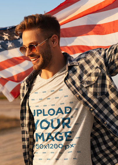 T-Shirt Mockup of a Stylish Man Holding an American Flag 45789-r-el2