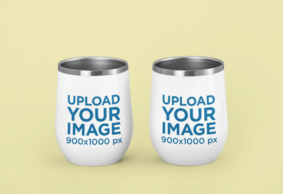 Mockup of Two Wine Tumblers Against a Solid Color Background m226