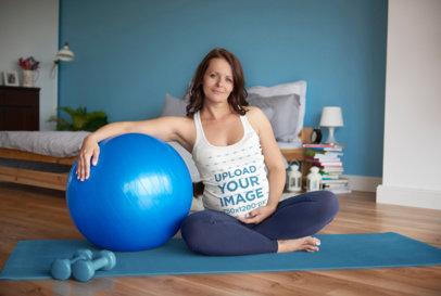 Tank Top Mockup Featuring a Pregnant Woman Doing Yoga at Home 34998-r-el2