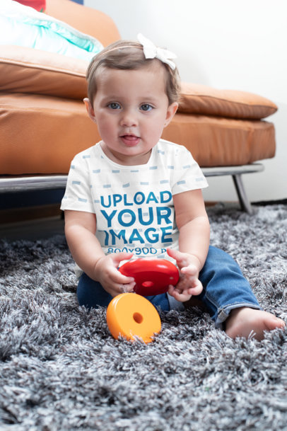 Sublimated T-Shirt Mockup of a Baby Girl Playing with Toys M937