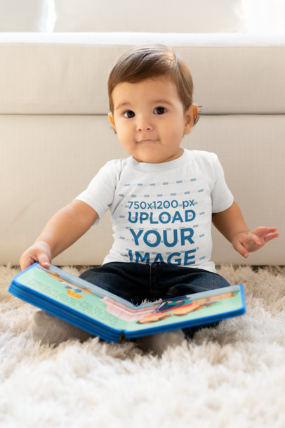 T-Shirt Mockup of a Toddler Playing with a Book m1001
