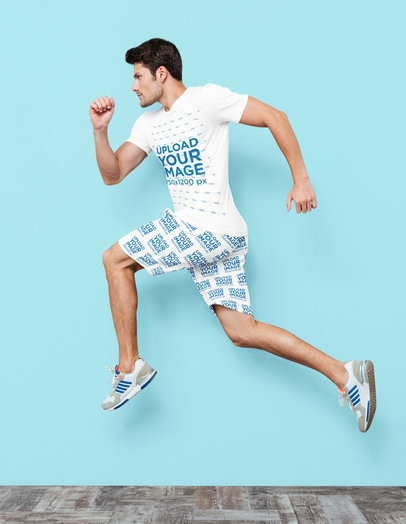 T-Shirt and Sublimated Shorts Mockup of an Athletic Man in a Dynamic Pose 35718-r-el2