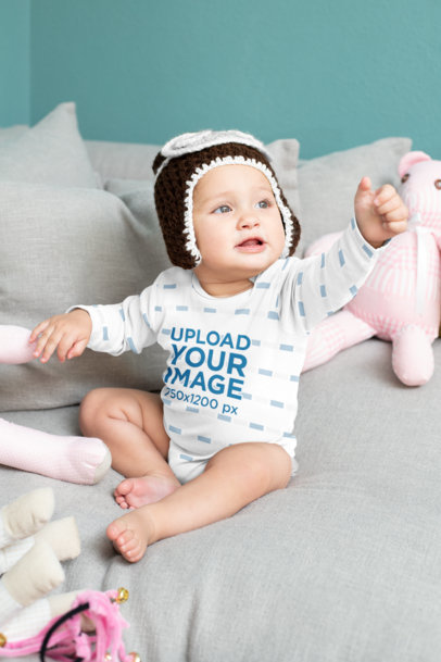 Mockup of a Baby Wearing a Sublimated Long-Sleeve Onesie M930