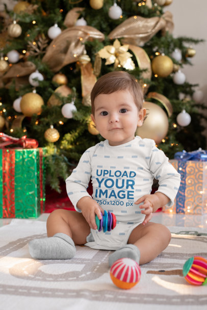 Sublimated Onesie Mockup Featuring a Baby by a Christmas Tree m987