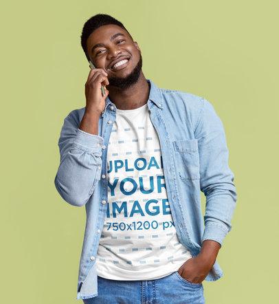 T-Shirt Mockup of a Man Talking on the Phone at a Studio 46084-r-el2