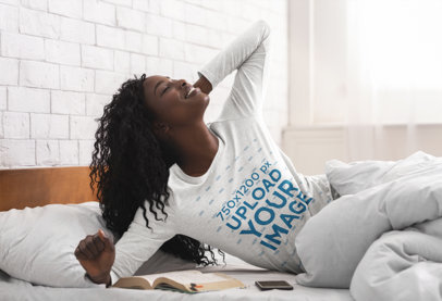 Mockup of a Woman Reading in Bed in a Heather Long Sleeve Tee 46076-r-el2