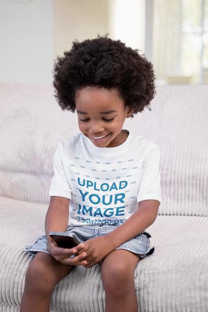 T-Shirt Mockup of a Happy Kid Using a Smartphone 46122-r-el2