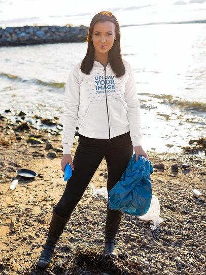 Full-Zip Hoodie Mockup Featuring a Woman Cleaning a Beach 46222-r-el2