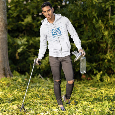 Mockup Featuring a Man Wearing a Full-Zip Hoodie While Cleaning a Park 46326-r-el2