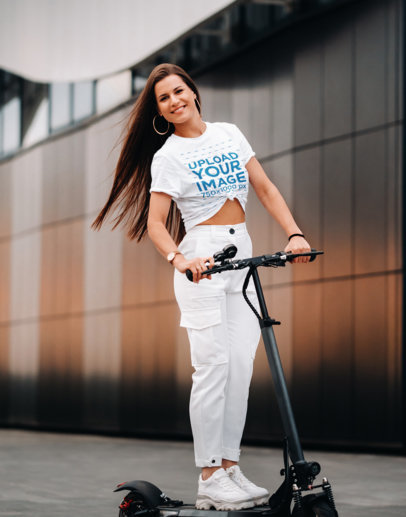 Mockup of a Woman Wearing a Knotted Tee While Riding a Scooter 46417-r-el2