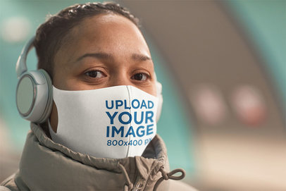 Mockup of a Woman Wearing a Face Mask While Listening to Music 46729-r-el2