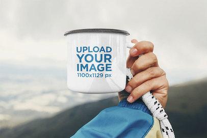 Mockup Featuring a Hand Holding an Enamel Mug Against a Natural Landscape 46885-r-el2